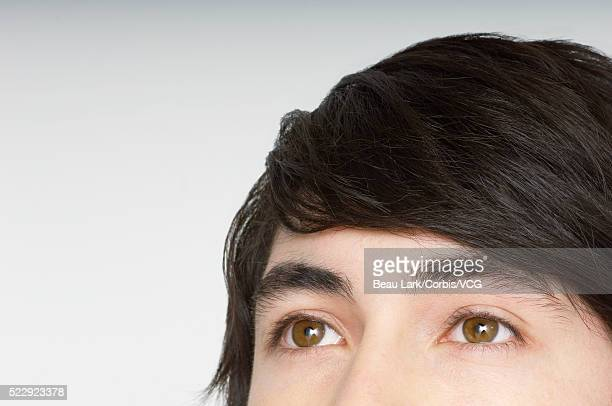 Boy with brown eyes looking up