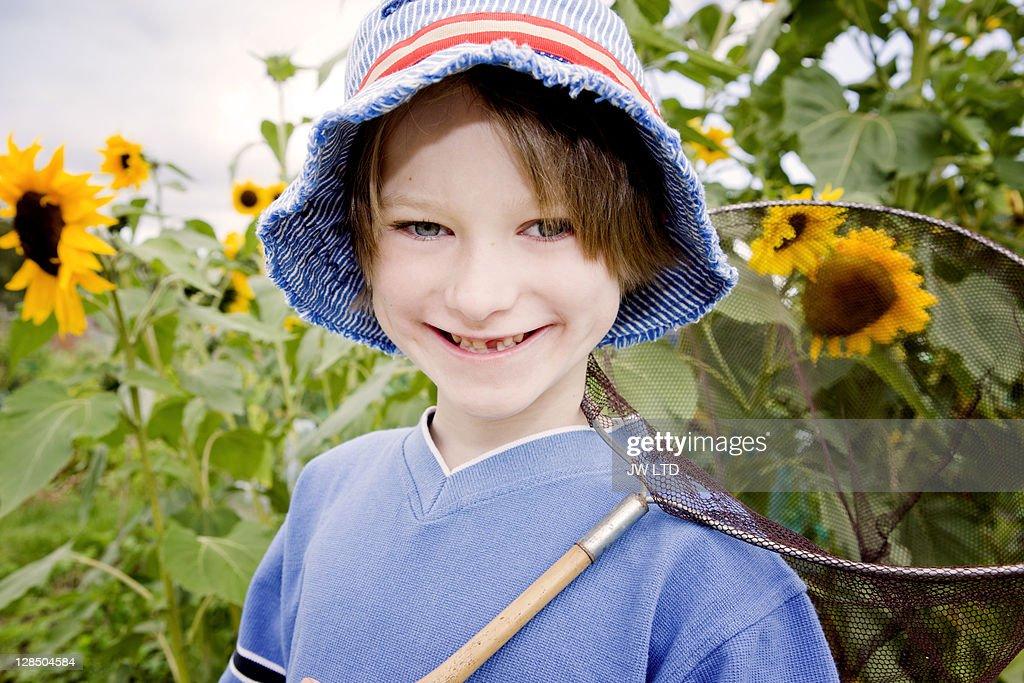 Boy with butterfly net, portrait : Stock Photo