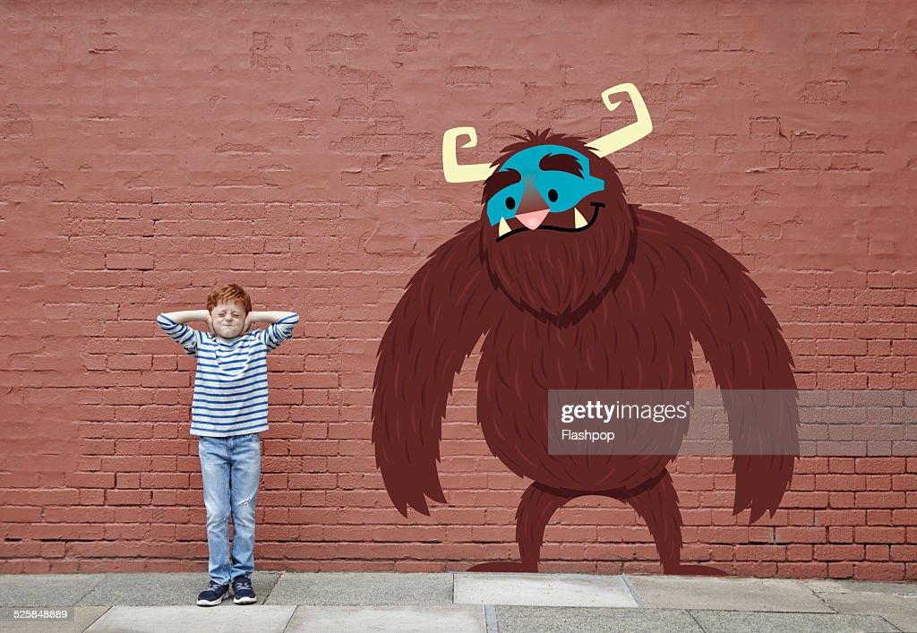 Boy with cartoon monster : Stock Photo