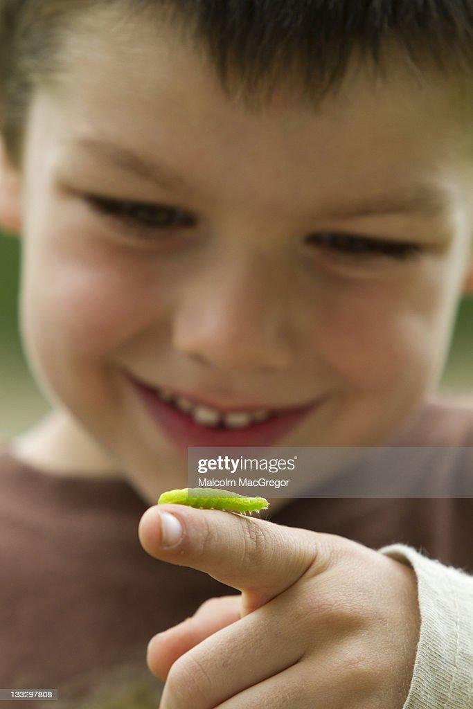 Boy with Caterpillar : Stock Photo