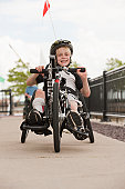 Boy with cerebral palsy in a racing bike