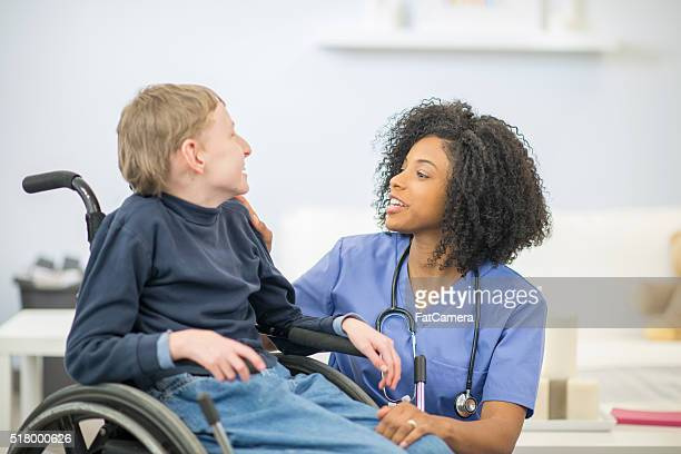Boy with Cerebral Palsy with a Nurse