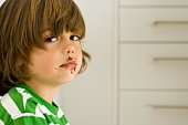 Boy with chocolate on face