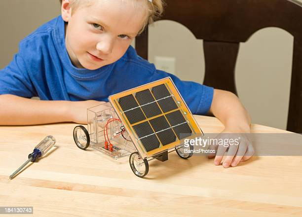 Boy with Completed Solar Car Project