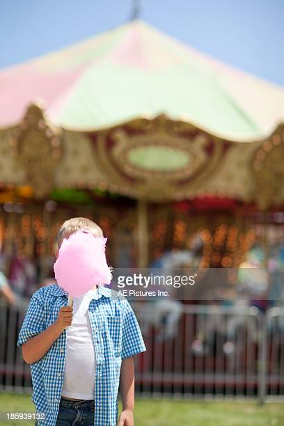 Boy with cotton candy at fair