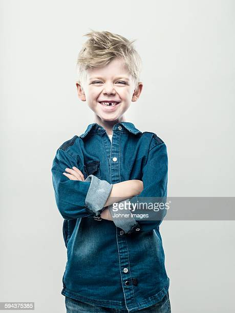 Boy with crossed arms