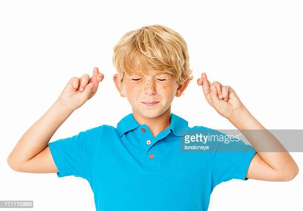 Boy With Crossed Fingers Making a Wish - Isolated