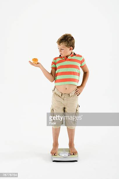 Boy with Cupcake on Scale