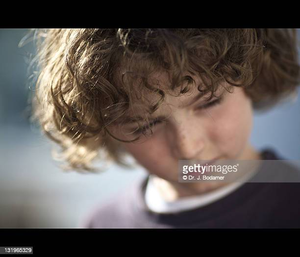 Boy with curly blonde hair