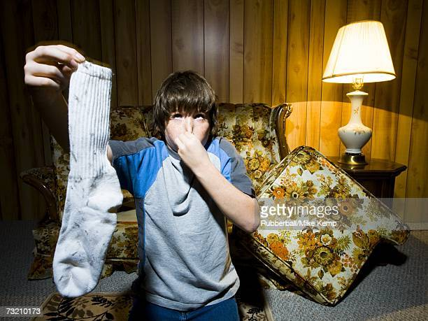 Boy with dirty sock