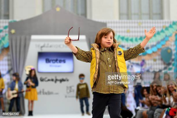 A boy with Down Syndrome presents a creation during 'The Petite Fashion Week' in Madrid on October 6 2017 Some of the models at the show are from the...
