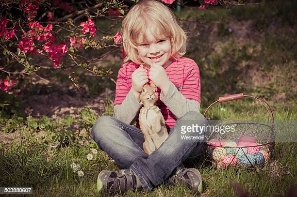 Boy with Easter bunny in garden