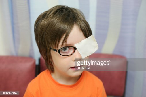 Boy with eye patch on glasses during test