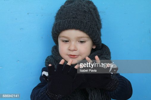 Boy with fingerless gloves