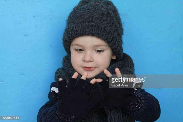 Boy with fingerless gloves