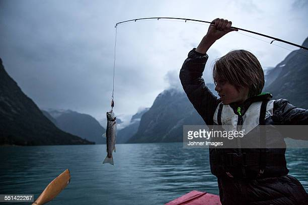 Boy with fish on hook