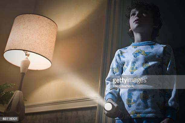 boy with flashlight searching at night