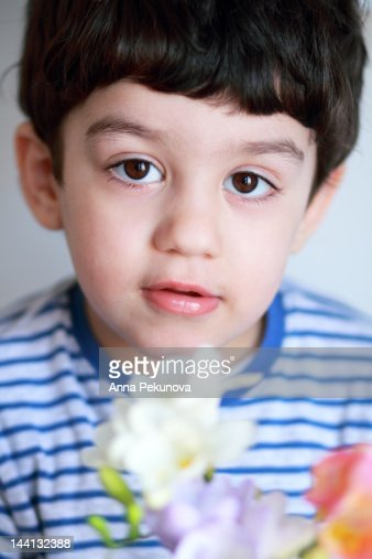 Boy with flowers : Stock Photo