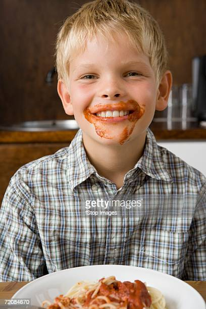 Boy with food around mouth smiling