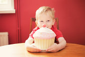 Boy with giant cupcake