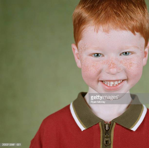 Boy (6-7) with ginger hair, smiling, portrait