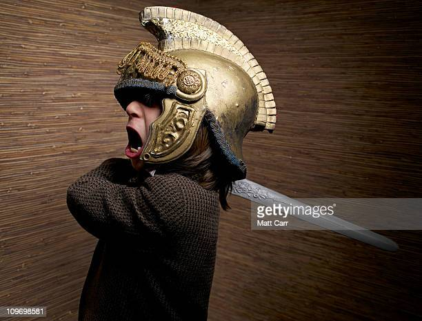 Boy with gladiator helmet