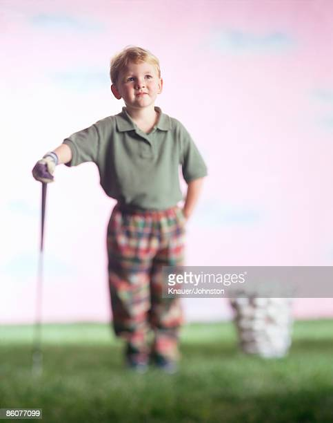 Boy with golf club