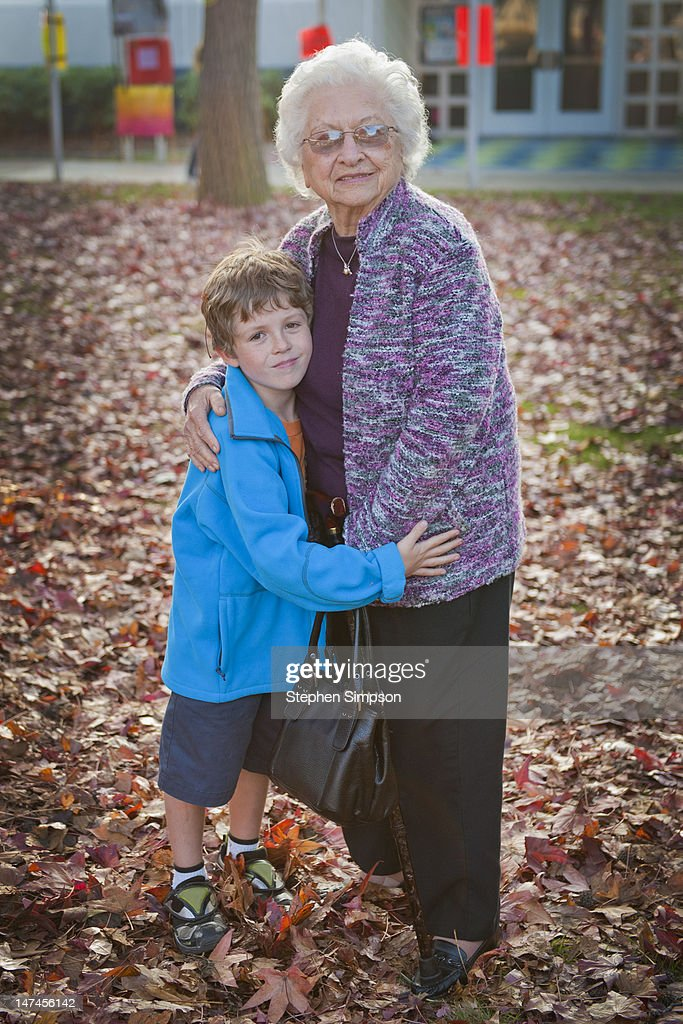 boy with grandma after school on a Fall day : Stock Photo