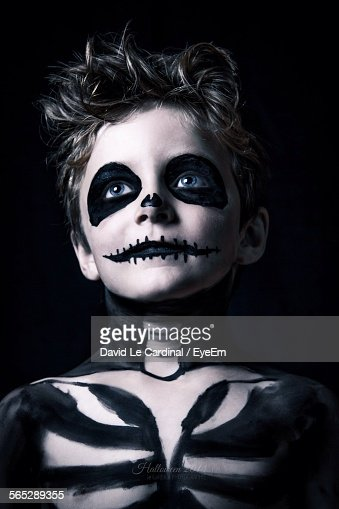 Boy With Halloween Makeup Against Black Background Stock Photo ...