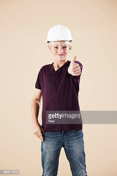 Boy with hard helm and thumbs up
