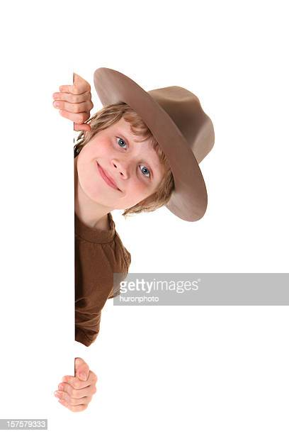 boy with hat peeking around card