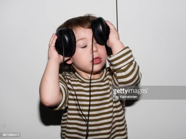 Boy with Head Phones on Head