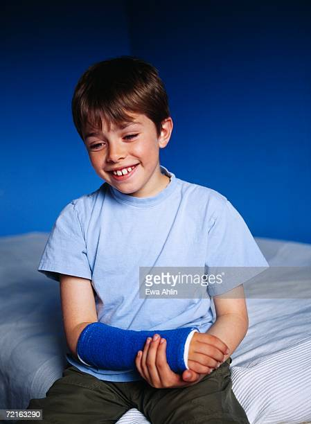Boy with his arm in a plaster.