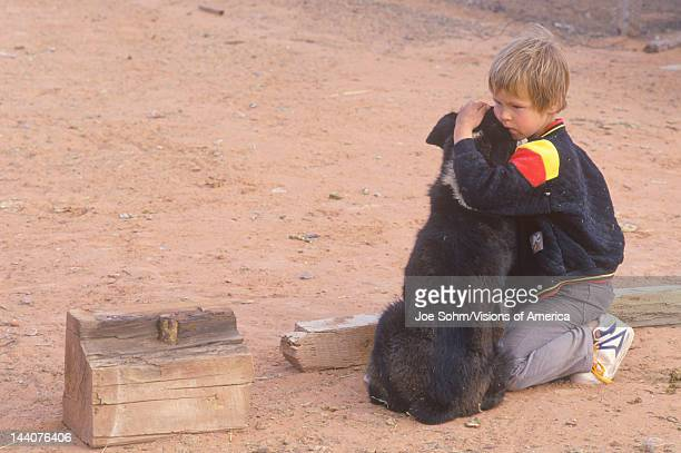 A boy with his dog UT