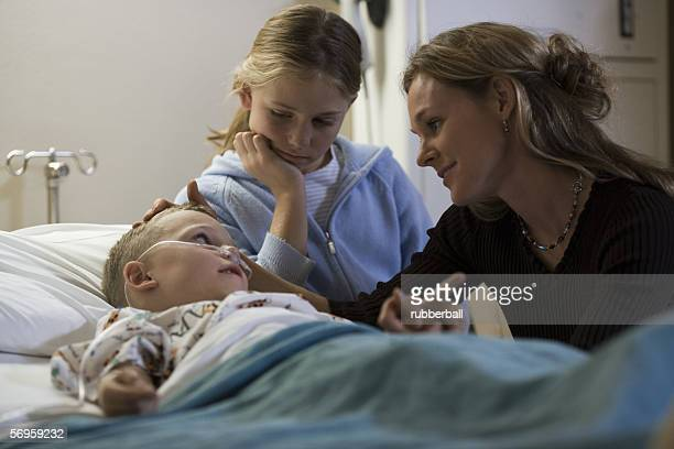 Boy with his mother and sister in the hospital