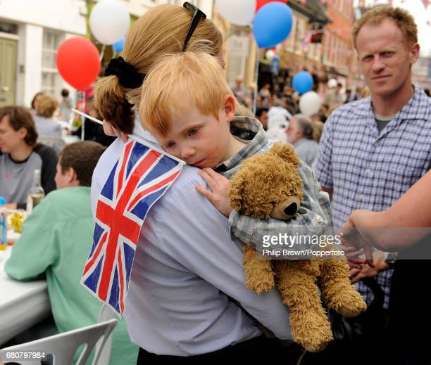 A boy with his teddy bear at a street party in Eton High Street near Windsor Castle on the day that Kate Middleton married Britains Prince William in...