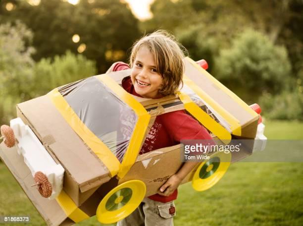 Boy with home made cardboard car