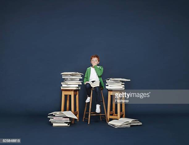 Boy with lots of books