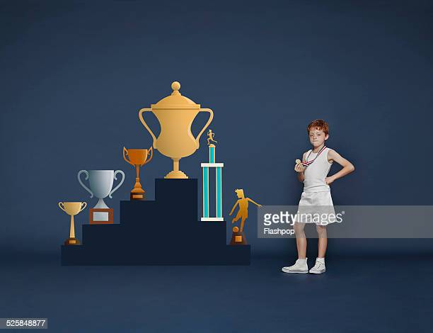 Boy with medal and trophies