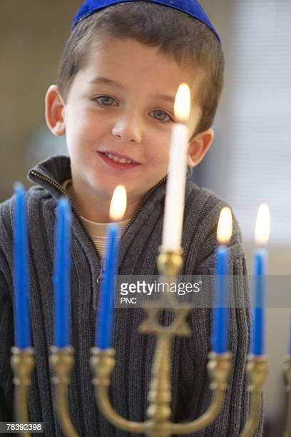 Boy with menorah
