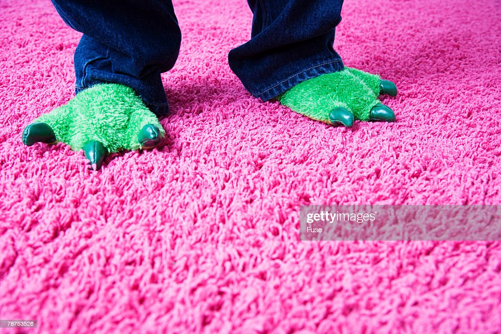 Boy with Monster Slippers Standing on Carpet