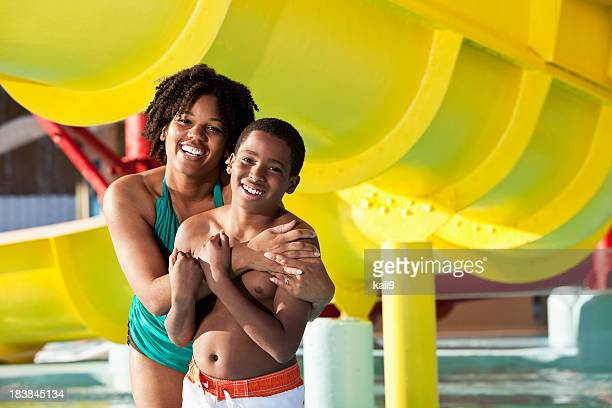 Boy with mother at water park