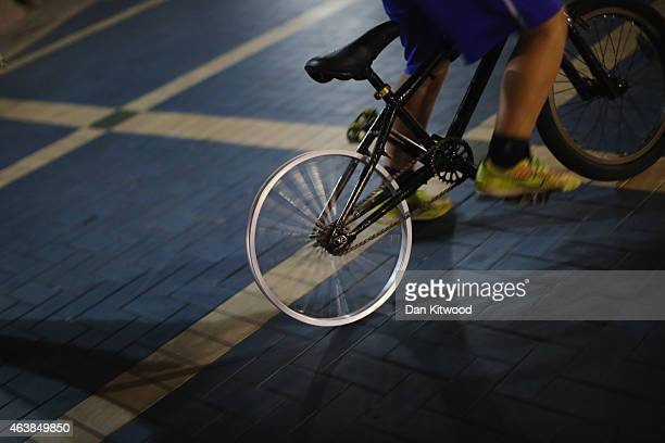 A boy with no tyre on his back wheel cycles down the Corniche on February 5 2015 in Abu Dhabi United Arab Emirates Abu Dhabi is the capital of the...