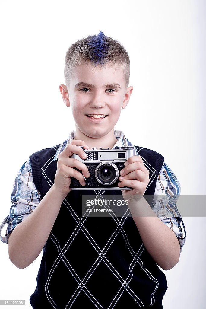 Boy with old camera : Stock Photo
