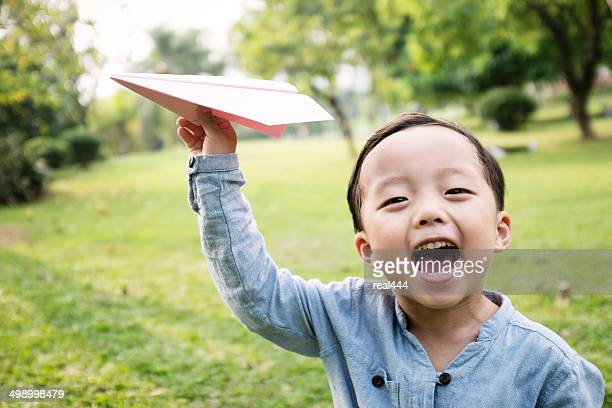 Boy with paper airplane