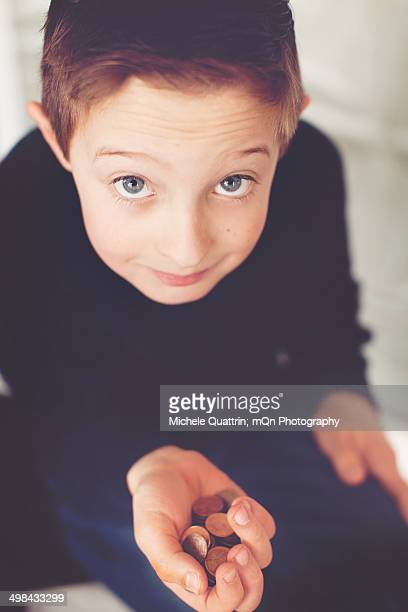 Boy with pennies