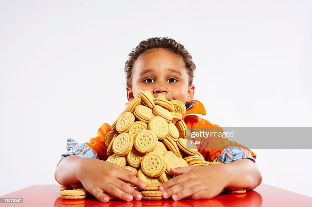 Boy With Pile of Cookies