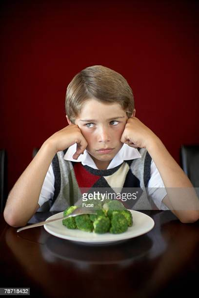 Boy with Plate of Broccoli