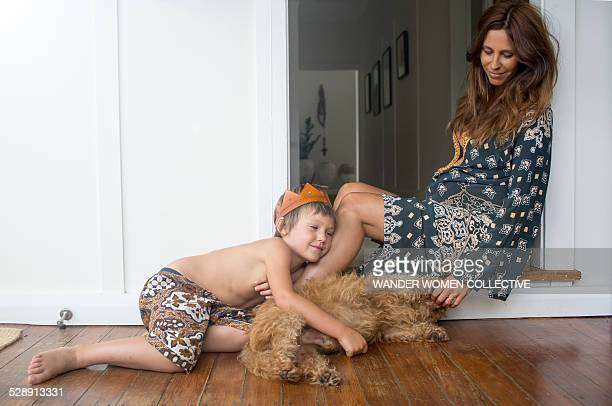Boy with pregnant mother and dog at home