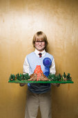 Boy with prize winning model volcano